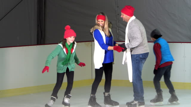 family with two children at ice skating rink - 10 11 years stock videos & royalty-free footage