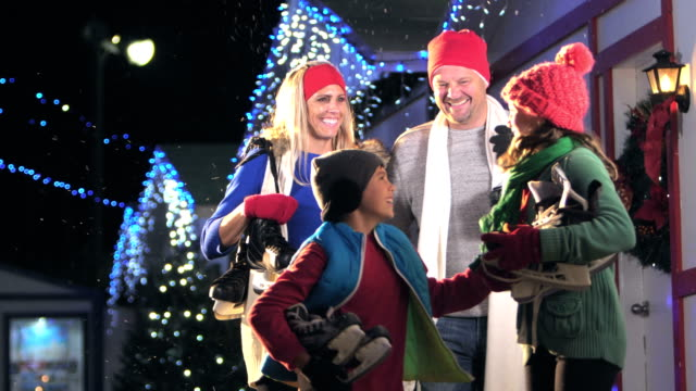 family with two children at winter festival, ice skates - 10 11 years stock videos & royalty-free footage
