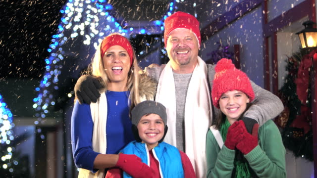 family with two children at winter festival - 10 11 years stock videos & royalty-free footage