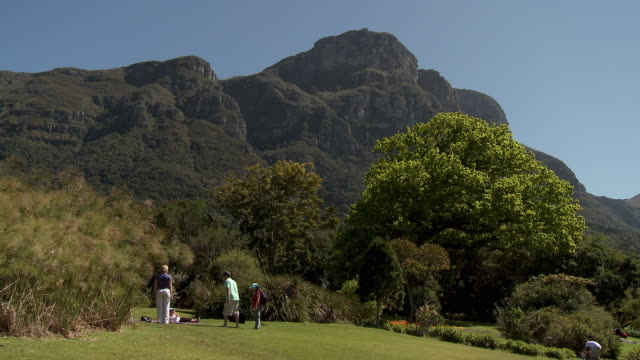 WS Family with two children relaxing on lawn in Kirstenbosch National Botanical Garden, Cape Town, Western Cape Province, South Africa
