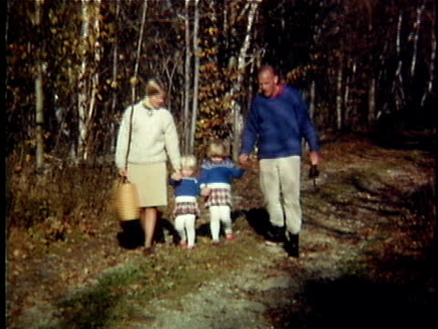 1963 WS Family with two daughters walking through forest, Vermont, USA