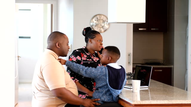 family working from home with son - routine stock videos & royalty-free footage