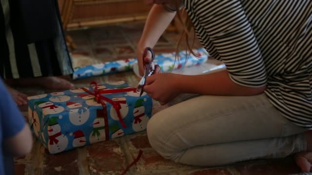 family wrapping  presents