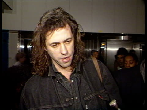 stockvideo's en b-roll-footage met geldof accuses government of failing to feed people as he returns to country england london heathrow airport int cms bob geldof interview sot drought... - bob geldof