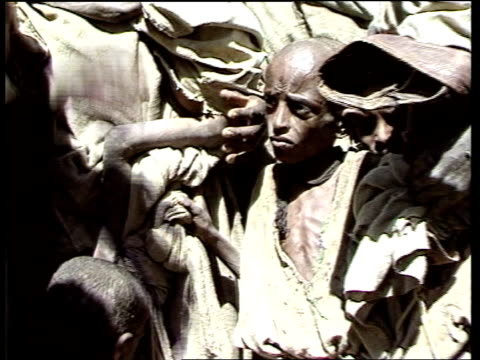 ethiopia / famine relief / world bank aid programme announced inj1978 / 11184 / itn mak'ale regugee camp cms women standing holding infants / cms... - unloading stock videos & royalty-free footage