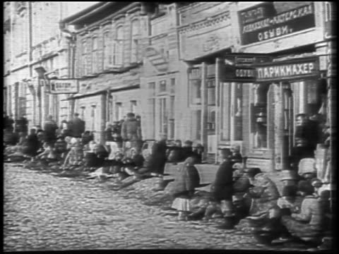 b/w 1921 famine victims sitting in street / russia / newsreel - 1921 stock videos & royalty-free footage