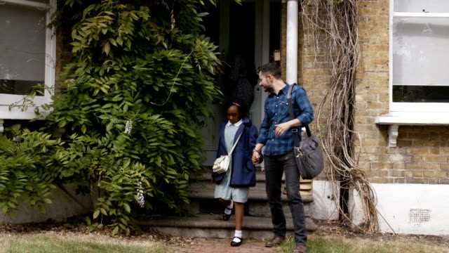 famliy walking out of their house - school uniform stock videos & royalty-free footage