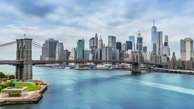 famous aerial view to new york city, brooklyn bridge, downtown - nyc stock videos and b-roll footage