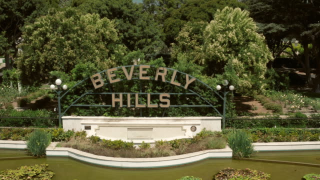 famous beverly hills sign - aerial drone shot - santa monica blvd stock videos & royalty-free footage