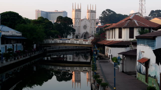 famous canals of malacca city in malaysia with church of st francis xavier - malacca stock videos and b-roll footage