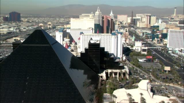famous casinos line the las vegas strip. - las vegas stock videos & royalty-free footage