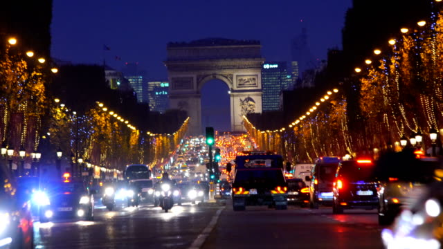 famous champs-elysees and arc de triomphe at twilight in paris - dusk stock videos & royalty-free footage
