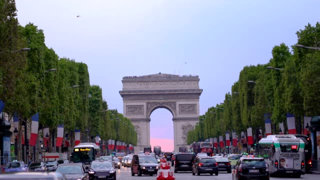 famous champs-elysees and arc de triomphe in paris - french revolution stock videos & royalty-free footage