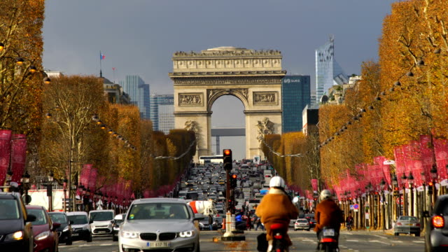 famous champs-elysees and arc de triomphe in paris - paris france stock videos & royalty-free footage