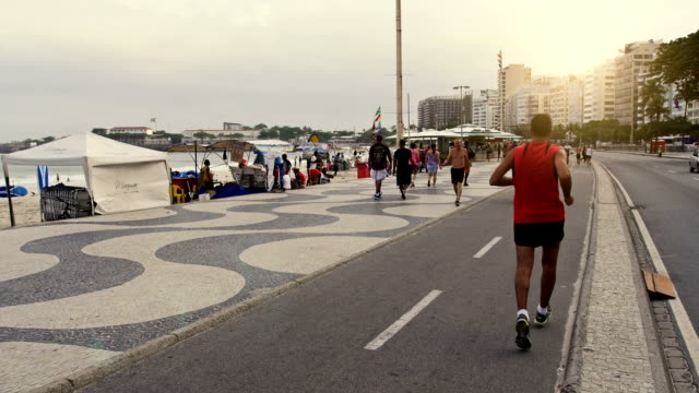 famous copacabana pedestrian walk - brazilian ethnicity stock videos & royalty-free footage