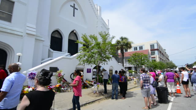 famous emanuel ame church in charleston south carolina black church people leaving flowers and messages and taking pictures of the scene of horrible... - charleston south carolina stock videos & royalty-free footage