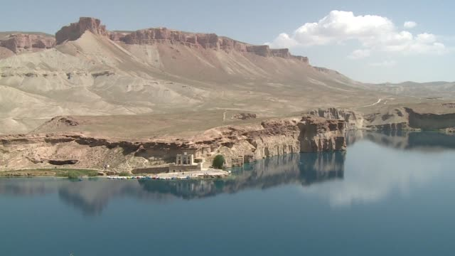 famous for its empty hillside niches that once sheltered the giant buddha statues blown up by the taliban bamiyan is a rare oasis of tranquillity in... - buddha stock videos & royalty-free footage