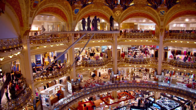 famous french store chain interior galeries lafayette in paris - chain store stock videos & royalty-free footage