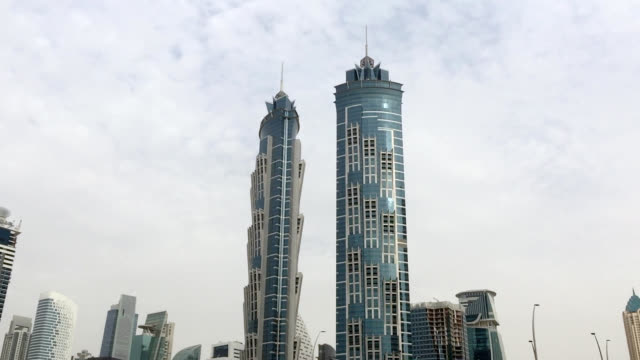 famous hotel towers and bridge over canal in dubai - tall high stock videos & royalty-free footage