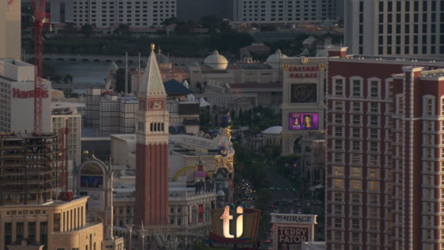 famous hotels and casinos dominate the las vegas strip. - venetian hotel las vegas stock videos & royalty-free footage