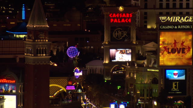 Famous hotels and casinos light up Las Vegas Boulevard at night.