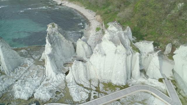 famous hotokegaura rocks in japan, aerial - aomori prefecture stock videos & royalty-free footage