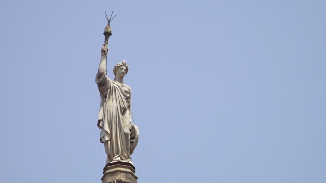 A famous Indian icon statue watches over the city