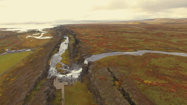 aerial famous landmark oxarafoss waterfall - iceland stock videos and b-roll footage