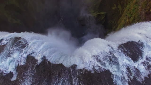 aerial famous landmark skogafoss waterfall - rapid stock videos & royalty-free footage