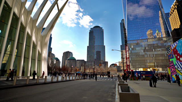 famous modern westfield world trade center. the city street. people walk on the square. sky reflection in the financial and corporate buildings - world trade center manhattan stock videos & royalty-free footage