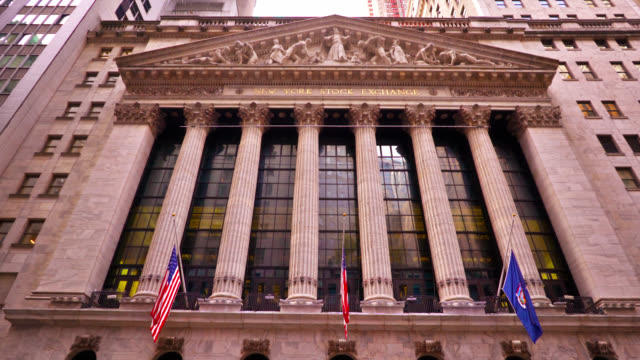 famous place: new york stock exchange. symbol. business and finance. wall street. - new york stock exchange stock videos & royalty-free footage