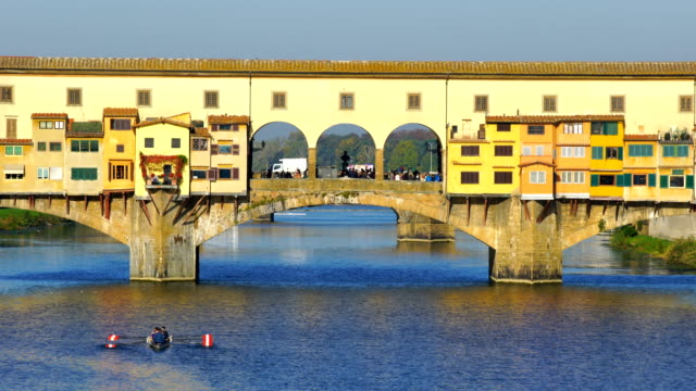 famous ponte vecchio bridge over the arno river in florence - ponte stock videos & royalty-free footage