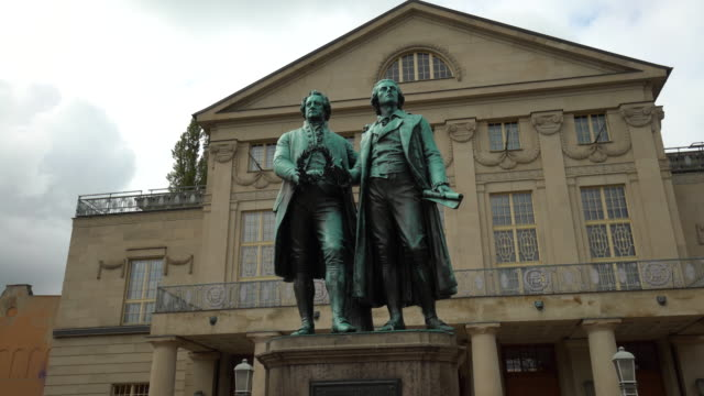 famous sculpture by goethe and schiller in the city of weimar - literature stock videos & royalty-free footage