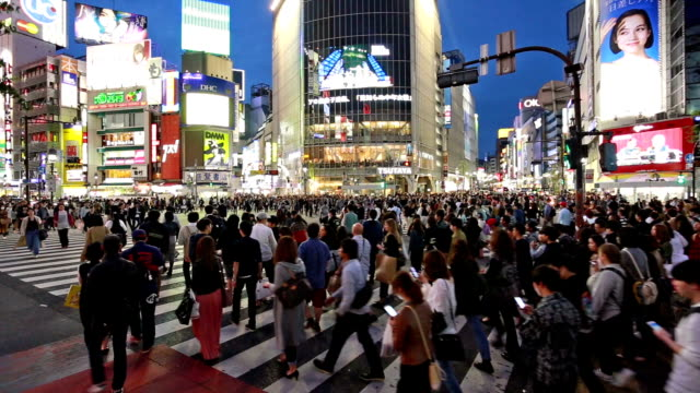 famous shibuya crossing in tokyo - pedestrian stock videos & royalty-free footage