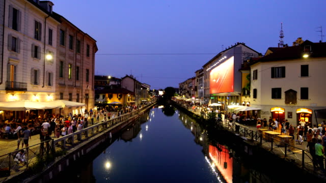 famous tourist attraction, naviglo grande canal in  milan city, italy - milano video stock e b–roll