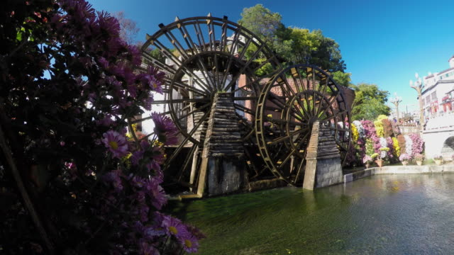 famous watermill in dayan old town. lijiang, china. - watermill stock videos and b-roll footage