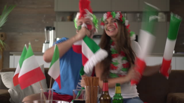 Fan couple cheering for Italy