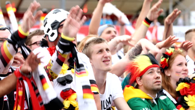 A fan gets upset and is looking disappointed after Germany lost the 2018 FIFA World Cup Russia Group F match against Korea Republic at the Kazan...