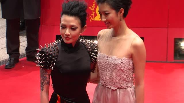 stockvideo's en b-roll-footage met fan hsiao shuan and zhou xun at flying swords of dragon gate premiere: 62nd international berlin film festival 2012 at berlinale palace on february... - mei