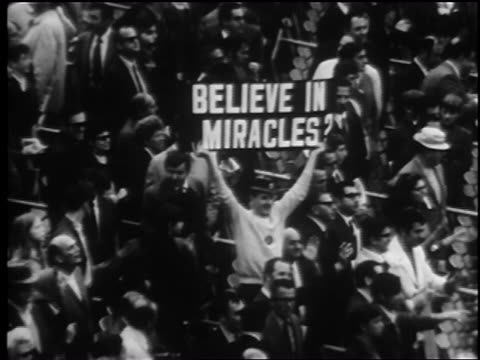 b/w 1969 fan in stands holding up believe in miracles sign at world series / newsreel - flushing meadows corona park stock videos and b-roll footage