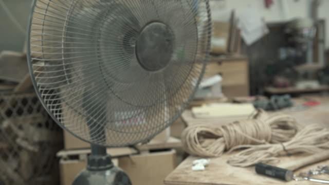 Fan is turning in woodwork studio