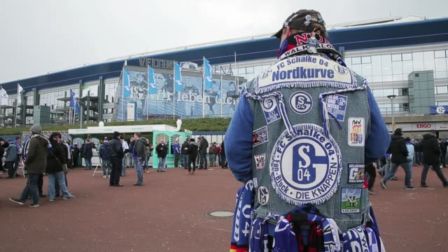 fan poses in front of the veltins-arena prior to the bundesliga match between fc schalke 04 and tsg 1899 hoffenheim at veltins-arena on march 30,... - 1899 stock videos & royalty-free footage