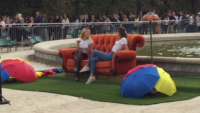 a fan poses with the sofa of the tv friends series in the jardin du palais royal to celebrate the 25th anniversary of the sitcom on september 12 2019... - fernsehserie stock-videos und b-roll-filmmaterial
