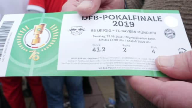 A fan proudly shows his ticket ahead of the DFB Cup Final 2019 between RB Leipzig and Bayern Muenchen at Olympiastadion on May 25 2019 in Berlin...