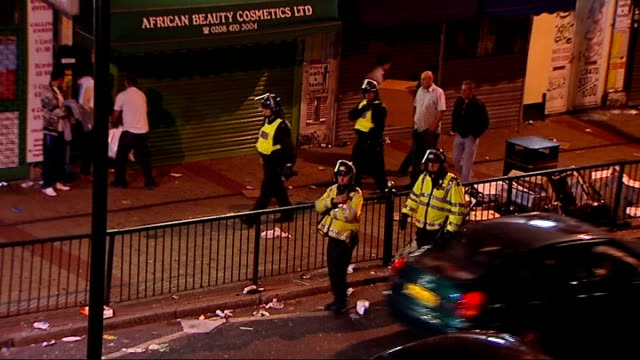 fan stabbed as violence breaks out at west ham vs millwall football match england london near upton park high angle view of police officers outside... - west ham fc stock-videos und b-roll-filmmaterial