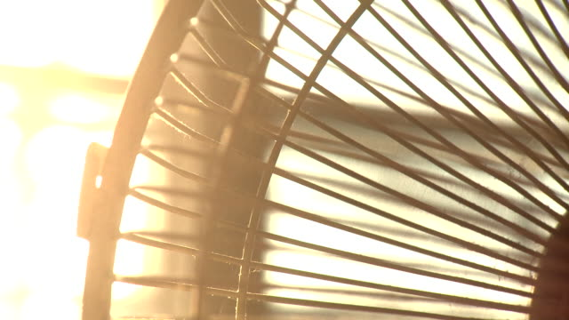 fan turning during heatwave - ventilator stock-videos und b-roll-filmmaterial