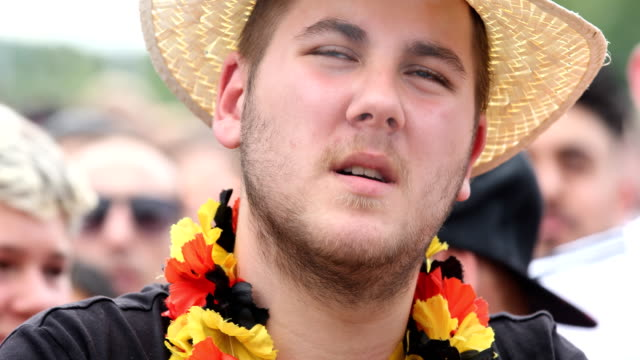 A fan who is smoking looks totally disappointed after Germany lost the 2018 FIFA World Cup Russia Group F match against Korea Republic at the Kazan...
