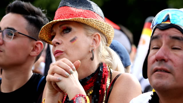 A fan with a hat in the colors of the German flag gets upset after Germany lost the 2018 FIFA World Cup Russia Group F match against Korea Republic...