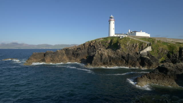 fanad head lighthouse in late afternoon light, antrim ireland - bay of water stock videos & royalty-free footage