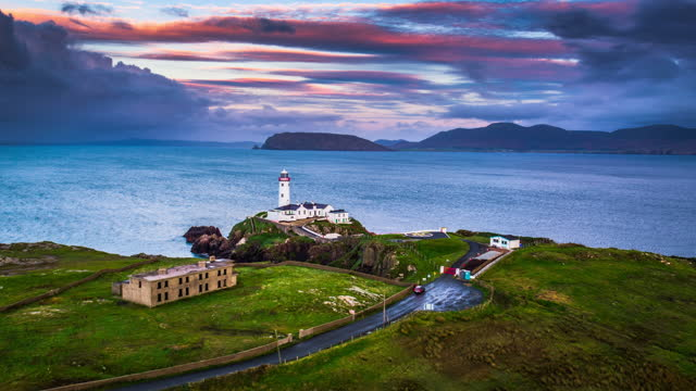 fanad head lighthouse on the fanad peninsula in ireland - aerial view - romantic sky stock videos & royalty-free footage